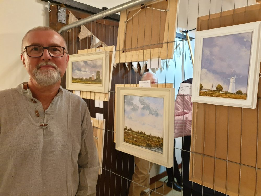 steve-with-paintings